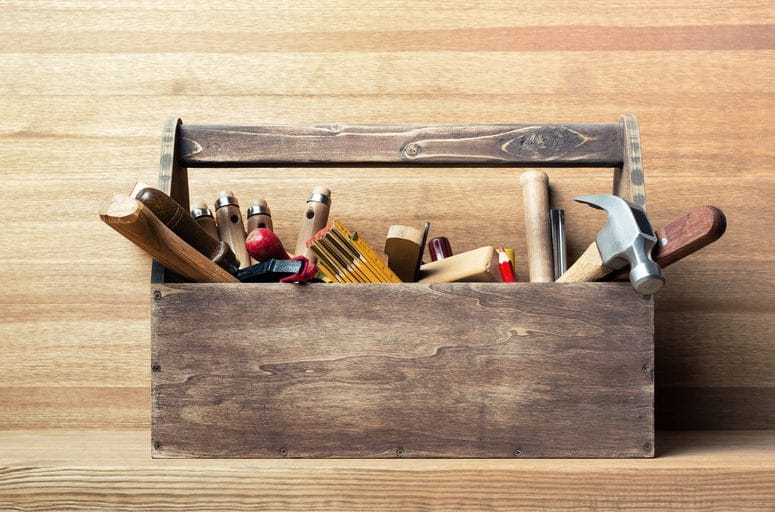 Wooden toolbox full of tools
